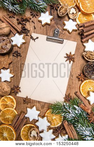 Christmas cookies and spices. Holidays food. Recipe book paper sheet