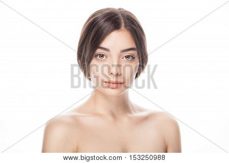 closeup portrait of young woman with clean fresh skin isolated on white background