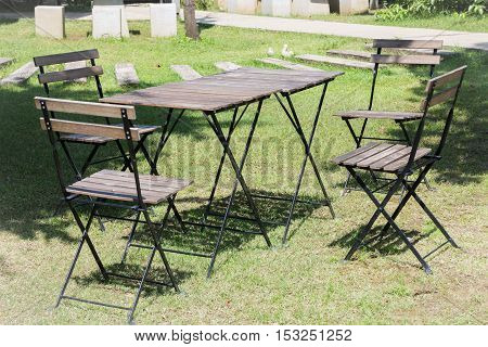 Outdoor tables and chairs set up on the green lawn stock photo