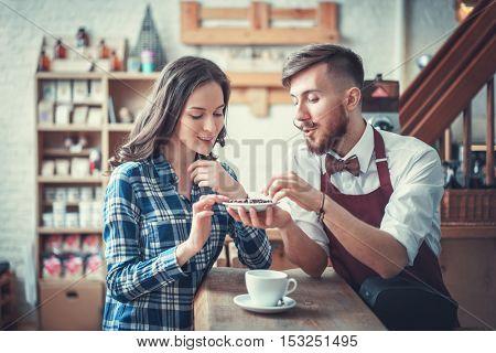 Barista and customer at the counter