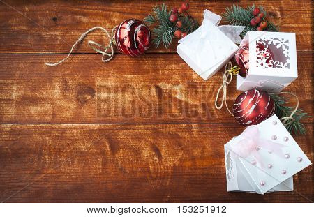 Christmas gifts, red balls on the wooden table
