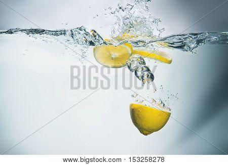Fresh Lemon In Water With Splash