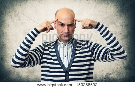 Serious Thinking Guy Over Concrete Wall