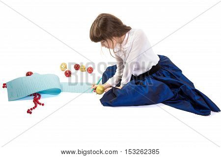 Girl writing a very long letter to Santa. Isolated on white background