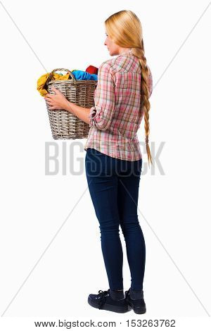 Back view of woman with  basket of dirty laundry. Rear view people collection.  backside view of person.  Isolated over white background. Girl with very long hair holds up a laundry basket.