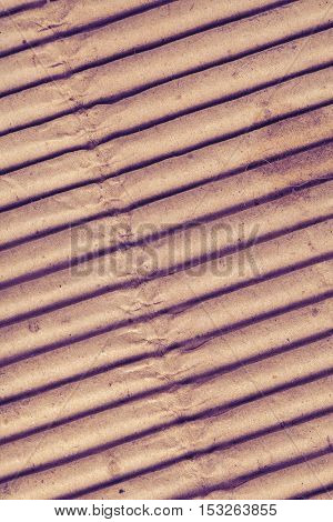 The corrugated convex cardboard textured background. Macro photo