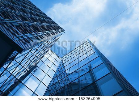 Tall office building with blue tint to whole image