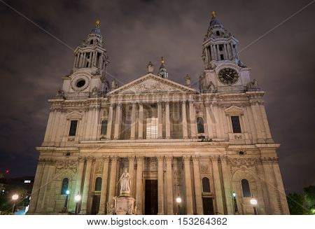 St Paul's Cathedral in London against a cloudy sky at night. Showing the front facade by Sir Christopher Wren.