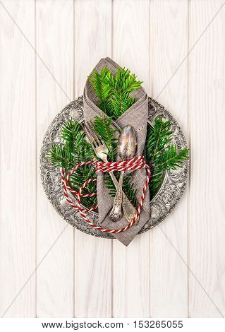 Christmas composition. Festive table place setting decoration with christmas tree brunches