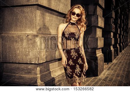 Beautiful fashion model walking down the city street. Fashion shot.