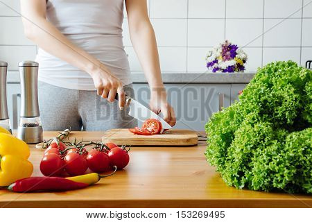 Young Woman Cooking Healthy Meal In The Kitchen