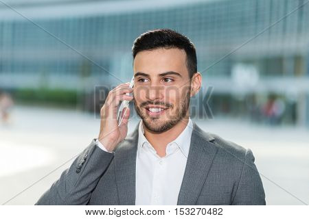 Smiling man talking on the cell phone