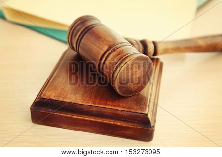 Court gavel and sound block on table, closeup