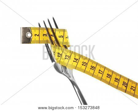 Fork with measuring tape on white  background
