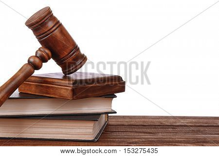 Gavel with sound block on books on white background