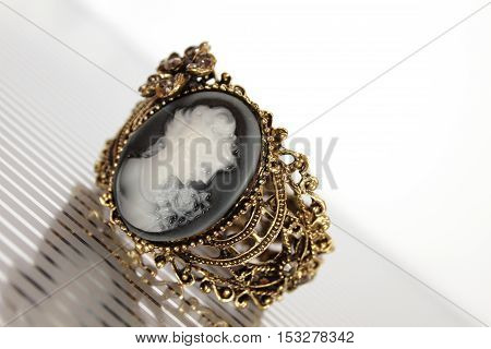 Bronze bracelet carved with the image of a girl silhouette