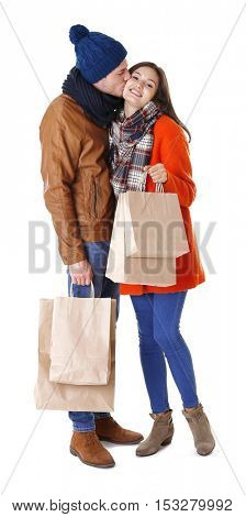 Happy couple with purchase isolated on white