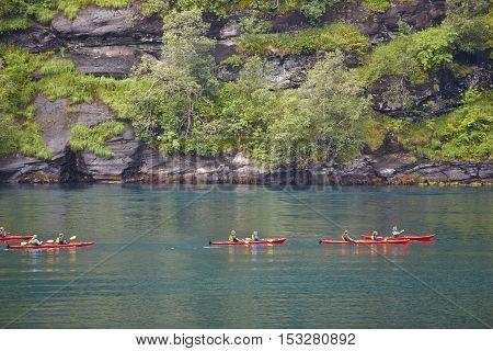 Norwegian fjord landscape with kayaks and rocks. Travel Norway. Horizontal