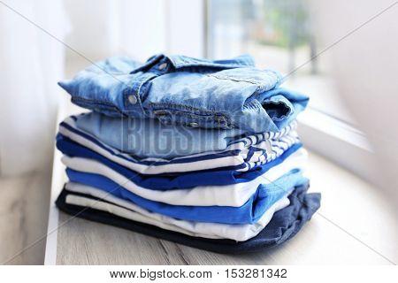Pile of clothes on windowsill, closeup