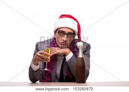 Young businessman celebrating christmas in office