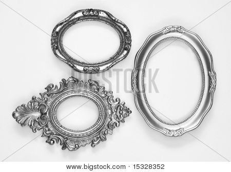 Silver ornate oval frames, one grunge and rusty