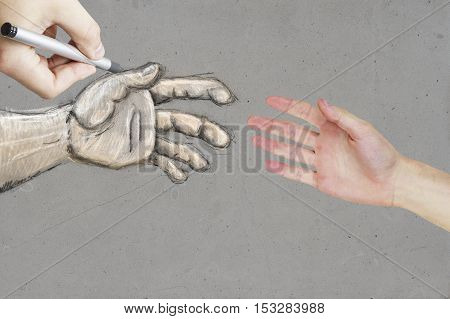 Real and drawn hands on textured concrete background