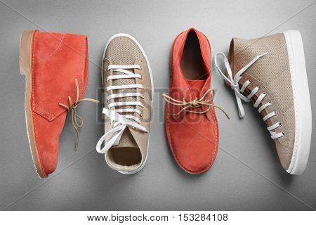 Grey and red shoes on grey background