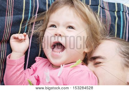 cheerful toddler and daddy having fun laughting very emotional