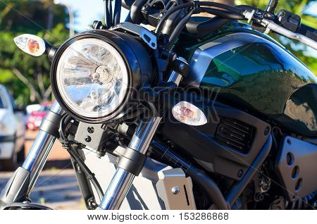 Close up of headlight. Motorcycle detail background.