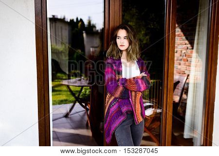 Portrait Of Sad Young Woman In Woolen Sweater