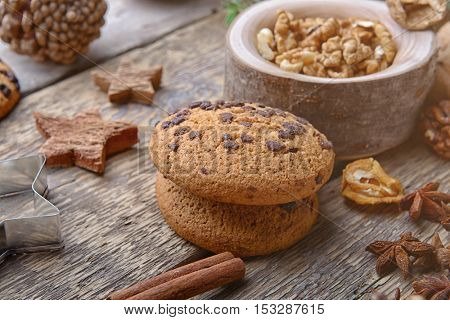 Composition of cookies and natural decor on wooden background, close up view