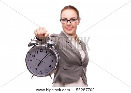 Businesswoman with giant alarm clock isolated on white