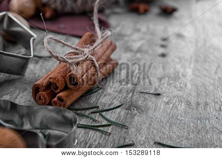 Close up view of cinnamon sticks on wooden background