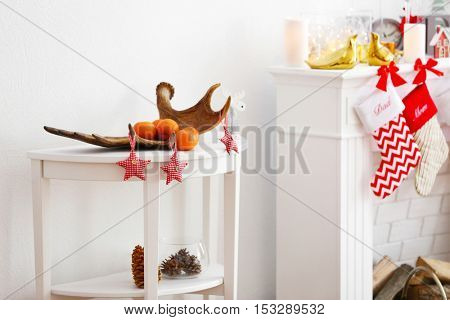 White table with Christmas decoration in room interior