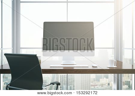 Close up of workplace with blank computer screen and other items on window with city view background. Mock up 3D Rendering