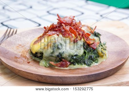 Baked spinach and cheese on plate / cooking Baked spinach concept