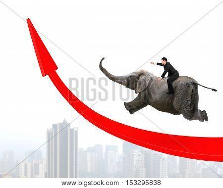 Businessman Riding Elephant On Red Arrow Up Trend Line