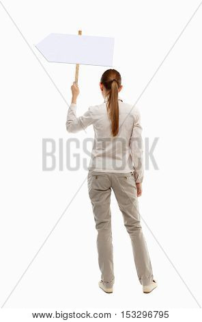 Back view woman showing sign board. man holds information plate. Rear view people collection. backside view person. Isolated over white background. girl in gray jacket holding pointer over your head