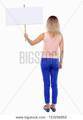 Back view woman showing sign board. man holds information plate. Rear view people collection. backside view of person. Isolated over white background. blonde in a pink shirt holds placard on stick