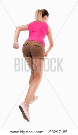 back view of running  woman. beautiful girl in motion. backside view of person.  Rear view people collection. Isolated over white background. The girl in brown shorts runs off into the distance.