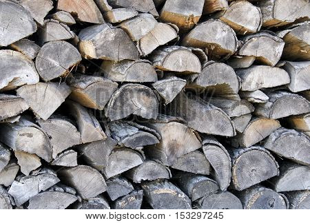 Several pieces of split logs make a chopped wood background