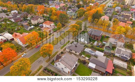 Street in auntumn in town by drone