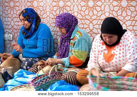 ESSAOUIRA, MOROCCO - JANUARY 15, 2014: Berber women have formed co-ops to produce and sell argan. Women earn about 40 dirhams for a days work.