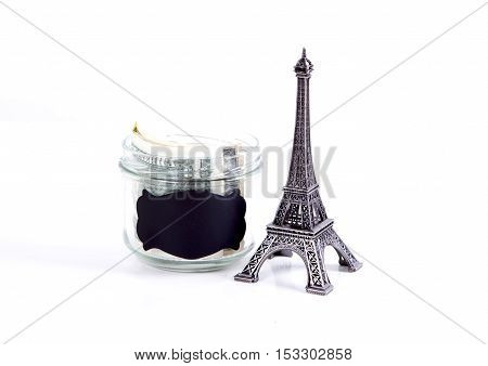 France concept with Eiffel Tower souvenir. Planning summer vacation money budget trip concept. Travel to Paris