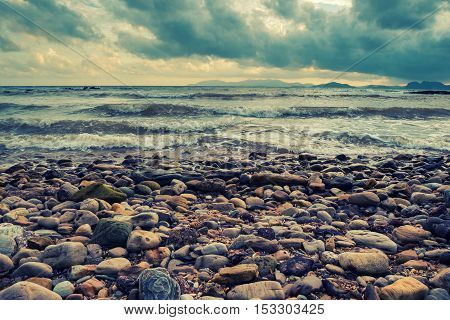 vintage colorful rock and beach and wave