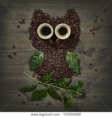Coffee owl from beans, leaves and cups