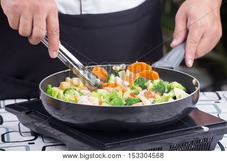 Chef stir fry vegetable / cooking stir fry Broccoli concept