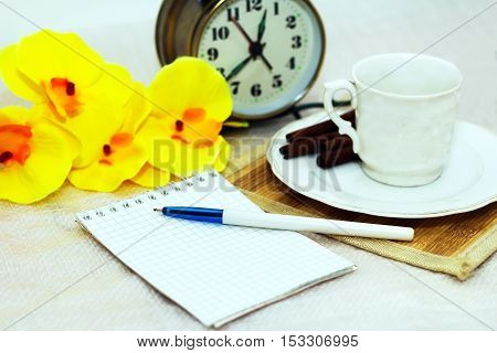Coffee Cup Notepad Orchid on the table. White background