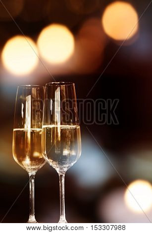 Festive background with two champagne glasses for celebratory events