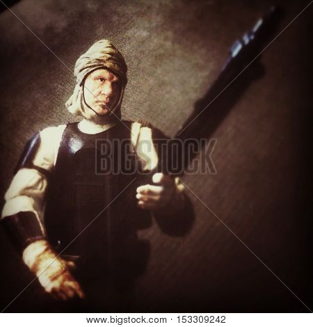 Star Wars The Vintage Collection Corellian bounty hunter Dengar posed against textured background